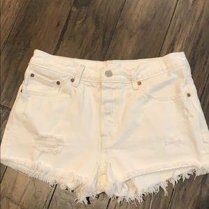 Distressed Levi's 501 white denim shorts